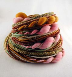 Bittersweet - Corespun yarn with twists and knitted bits (70yds) by moonroverspins, via Flickr