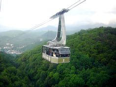 Incredible views await you on the Ober Gatlinburg Aerial Tram which literally suspends you over the Great Smoky Mountains on a path down to Gatlinburg, Tennessee. Ober Gatlinburg, Gatlinburg Vacation, Gatlinburg Tennessee, Tennessee Vacation, East Tennessee, Gatlinburg Attractions, Tennessee Camping, Local Attractions, Vacation Places