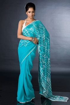 A screen printed georgette saree, handcrafted with sequins and fine bead work, comes with a crepe-de-chine blouse with matching embroidery by Satya Paul. $425