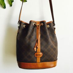 A personal favorite from my Etsy shop https://www.etsy.com/listing/279798986/vtg-bally-cross-grain-leather-bucket-bag