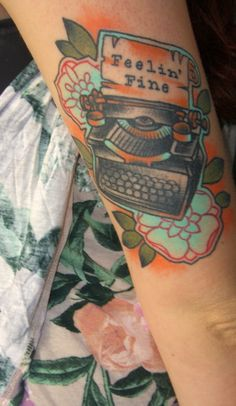 I'm planning on adding a typewriter to my forearm (going to start a sleeve to cover the blowout around Fievel). I like the style of this one. I wouldn't add words to the page, and no flowers (since I already have the tigerlilies on my shoulder).