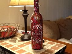 Lighted wine bottle, Christmas theme crafted using Gallery Glass, Martha Stewart Fine Glitter Glass Paint, rhinestone and pearl stickers and 20 strand Xmas lights.