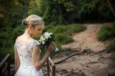 Next day shooting. Bride in the forest with her bouquette
