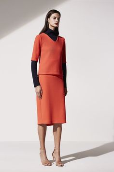 Work Outfit Idea from Ann Taylor: Powerful Red Separates, Styled With a Classic Black Turtleneck // Explore More Work Style Ideas from Ann Taylor: (http://www.racked.com/2015/10/30/9642804/ann-taylor-spring-2016-collection#4867343)