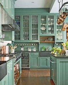 Cabinetry that goes on forever!  15 Kitchens with Bright Green Cabinets