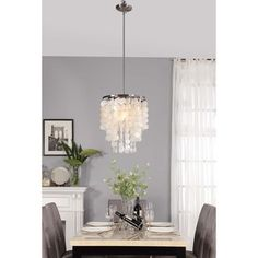 @Overstock - Athena Capiz Shell Pendant - Refined, but casual and fun, this dangling chandelier-style Athena pendant features capiz shell accents. The nickel hardware finish completes this modern light fixture's cool appearance.  http://www.overstock.com/Home-Garden/Athena-Capiz-Shell-Pendant/9316451/product.html?CID=214117 $116.99