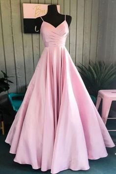 Blushing Pink Spaghetti Straps Ruffled V-neck A-line Long #Promdress #Gown.  SKU:  2327. Year: 2019. Shown Color: Blushing Pink. Silhouette: A-line. Sleeve:  Sleeveless. Back Style:  Open Back Zipper Up. Fabric:  Satin. Neckline:  V-neck, Spaghetti Straps. Built-In Bra: Yes. Hemline/Train:  Floor-Length. Embellishment: Ruffles. Season: Spring, Summer, Fall, Winter