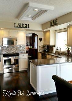 benjamin moore best neutral and beige light colour is grant beige, cream kitchen cabinets and dark wood floor in kitchen, neutral undertone