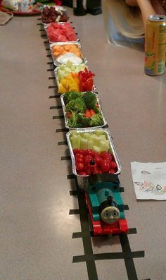 The Thomas the Train snack train I made for my son's third birthday. It was so easy and cheap to make. It's just 3, two packs of aluminum loaf pans from Walma