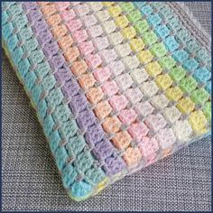 Vintage Rainbow crochet baby blanket kit – the ideal handmade gift for a baby shower or new arrival! Make a beautiful unisex cot blanket in pastel rainbow colours. Easy and fast to crochet – the perfect gift for a baby shower or new arrival. Crochet Afghans, Easy Crochet Blanket, Crochet Blanket Patterns, Easy Baby Blanket, Crochet Gifts, Crochet Hooks, Bead Crochet, Cot Blankets, Rainbow Crochet