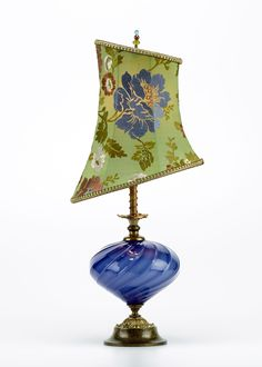 Irene by Susan Kinzig and Caryn Kinzig. Vibrant cobalt blue blown glass with small asymmetric shade. The fabric is embroidered green silk with a floral design. Single bulb. Beaded finial.