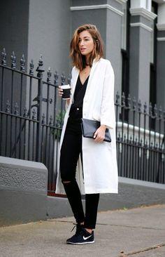 Shop this look on Lookastic: http://lookastic.com/women/looks/low-top-sneakers-skinny-jeans-coat-clutch-tank/5896 — Black Low Top Sneakers — Black Ripped Skinny Jeans — White Coat — Black Leather Clutch — Black Tank