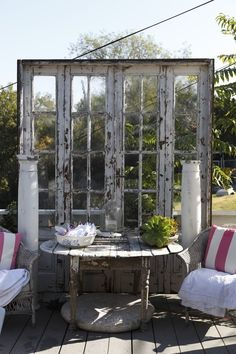 Old windows & other architectural details on a deck or patio area = A really neat idea!