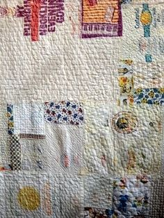 herminehesse:  Pieced quilt - date unknown found on Quilter's Pastiche website in archives Interesting because it has straight lines, circles, large writing, white space, old calicoes, plaids.......