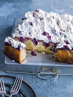 This lemon and blueberry poke cake is sure to be a hit with the whole family. It's easy to make but tastes and looks delicious.