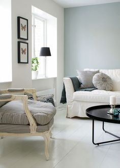 I love the one soft blue-grey wall and the subtle black/white/grey theme.  Also the white plank floor.