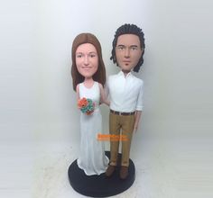 Custom Cake Toppers with the bride on the grooms back Piggy back