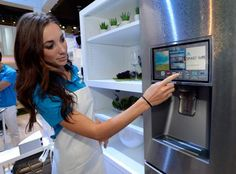 CES 2014 Samsung spokesmodel Kai Madden displays the connectivity feature on a Samsung smart refrigerator at the International CES in Las Vegas. Dumb Ways, Cyber Attack, Appliance Repair, The Next Big Thing, Doing Laundry, Home Comforts, Sem Internet, Home Automation, Smart Home