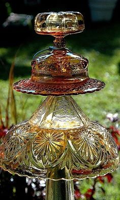 Glass garden ornament -Two sisters started making these ornaments out of antique glass pieces that were flawed in some way. They make for beautiful pieces in the garden