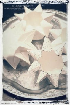 DIY Origami paper star lanterns : could do it with red paper  and put the little tea lights you have in them