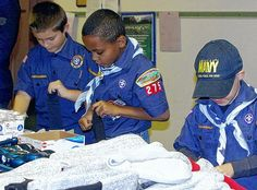 Santa Claus may fill stockings with goodies, but Grove City Pack 275 Cub Scouts use tube socks to spread holiday cheer.