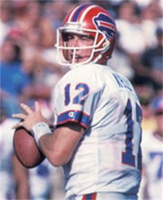 """Jim Kelly : Quarterback - Pro Football Hall of Fame Class of 2002  Class of 2002 Quarterback >>> 6-3, 225 (Miami - Florida) 1986-1996 Buffalo Bills  James Edward Kelly…Selected by Bills in 1st round, 1983 draft…Passed for more than 3,000 yards in season eight times…Mastered Bills' """"no huddle"""" offense…Guided Buffalo to eight post-season appearances, unprecedented four straight Super Bowls…Named to four Pro Bowls…Career stats: 35,467 yards, 237 touchdowns, 84.4 passer rating…Led NFL with…"""