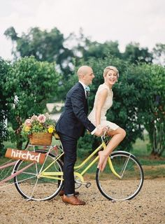 """Though you might want to practice the """"great escape"""" a couple of times before you do it for real, a vintage bicycle is the best two-wheel carriage that a bride could ask for. Powered by nothing else but your hubby's strength, you'll be laughing and crying as you zig-zag your way down the lane with this wedding getaway."""