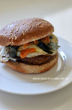 korean burger with kimchi and egg This looks weird... But I'd eat it... That's what she said
