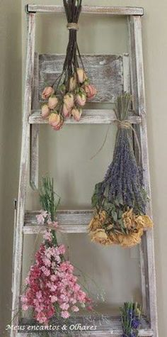 shabby chic farmhouse decor: hanging dried flowers on a rustic ladder