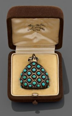 A silver, turquoise, enamel and gold box perfum by Rene Boivin, circa 1935.