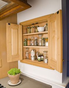 shallow, built-in cabinet that is flush with the wall...interesting and adaptable space-saving thought.
