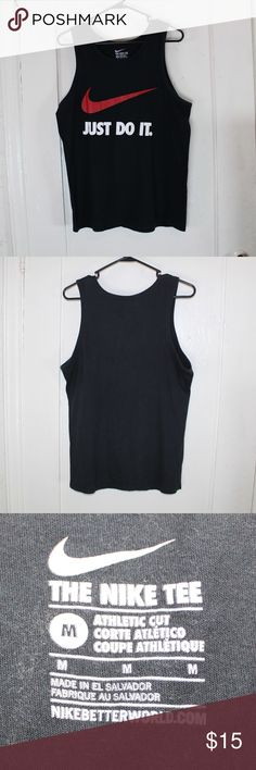 """NIKE JUST DO IT BLACK TANK TOP SIDE MEDIUM USED BUT IN GREAT CONDITION. A LITTLE TOO SMALL FOR MY SIZE. SIZE MEDIUM. 100% COTTON. BLACK WITH RED NIKE SWOOSH AND WHITE TEXT THAT READS """"JUST DO IT"""". GREAT FOR RUNNING OR WEIGHT TRAINING. Nike Shirts Tank Tops"""