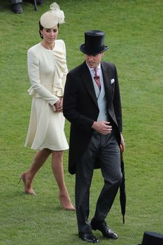 Prince William, Duke of Cambridge and Catherine, Duchess of Cambridge arrive for the Queen's garden party at Buckingham Palace on May 24, 2016 in London, England.