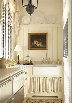 Love this look!  big sink with wood panelling  simple curtains to cover the plumbing.
