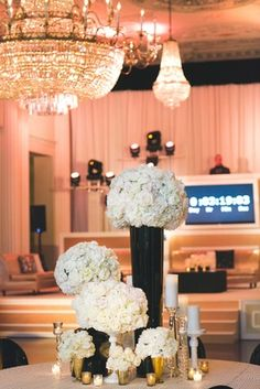 Modern, Black & White Centerpieces with Gold Candle Votives | Photography: Rob and Wynter Photography. Read More:  http://www.insideweddings.com/weddings/mlb-players-white-black-gold-nye-ballroom-wedding-in-atlanta/806/