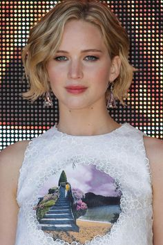 Jennifer Lawrence looking gorgeous at Cannes. Making me yearn for the days of my bob...and some sunshine.