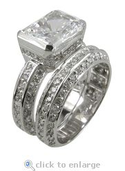 Cubic Zirconia Emerald Cut Wedding Set 14K White Gold By Ziamond.  The Luxotica Wedding Set is featured with a 4 carat emerald radiant cut center in a semi bezel setting with pave set round cubic zirconia and a fitted matching band.  $1795 #ziamond #cubiczirconia #cz #weddingset #bridalset #solitaire #ring #matchingband #14kgold
