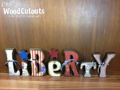"""Unfinished Liberty Letter Set Craft. This craft is about 36"""" in length and 9.25"""" high and costs $23.99."""