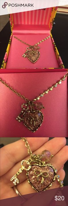 💥FINAL PRICE💥Betsey Johnson necklace Betsey Johnson charm necklace. Two small jewels missing from the key, see picture. Comes with original box! 💥Will be donated 10/01💥 Betsey Johnson Jewelry Necklaces
