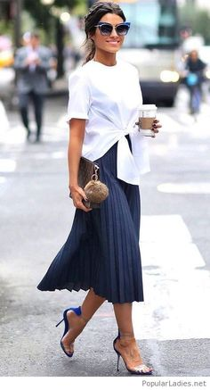 White top and navy skirt