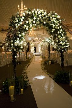 White arch with branches and lots of draped fabric