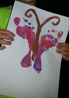 Simple children's footprint art. Paint feet, stamp on paper, add the body/antenna with painted fingers, let dry. Makes a spring butterfly.