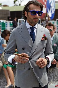 Nice jacket and glasses. But please don't smoke cigars