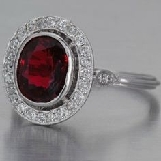 Art Deco ruby ring with old mine-cut diamonds in antique style platinum, 14mm wide and 5.5mm deep.