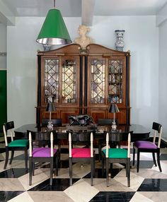 bold color.  dining room. geometric tile. old and new.