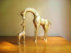 Vintage Solid Brass Giraffe and Baby Giraffe Figurines, Mother and Baby Giraffe, Brass African Animals, Pair. $68.00, via Etsy.