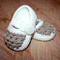 Two Colour Baby Slippers by MonPetitViolon | Crocheting Pattern - Looking for a crocheting pattern for your next project? Look no further than Two Colour Baby Slippers from MonPetitViolon! - via @Craftsy