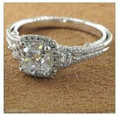 Gorgeous!!! Everything I love! Cushion cut and a unique band :)