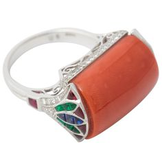 A Coral, Calibré Cut Ruby, Emerald, Sapphire and Diamond Platinum Dress Ring. | From a unique collection of vintage cocktail rings at http://www.1stdibs.com/jewelry/rings/cocktail-rings/