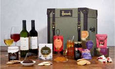 """A range of the most popular treats from the Food Halls, this hamper will bring a smile to the face of anyone who receives it. A red wine and a white wine – furnished with a """"wine waiter"""" corkscrew – are accompanied by three classic teas, plus jams, relish and nibbles."""